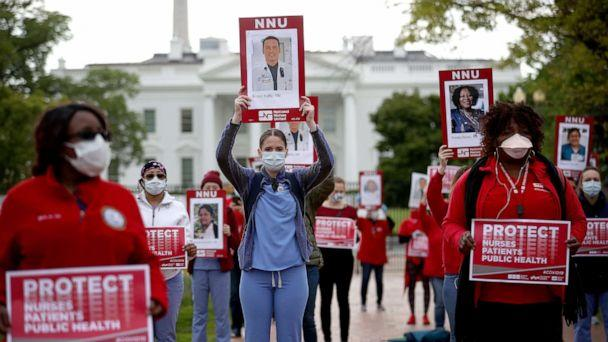 PHOTO: Registered nurses who are members of National Nurses United, the largest nurses union in the United States, protest in front of the White House, April 21, 2020 in Washington, D.C., to draw attention to the lack of personal protective equipment. (Win McNamee/Getty Images)