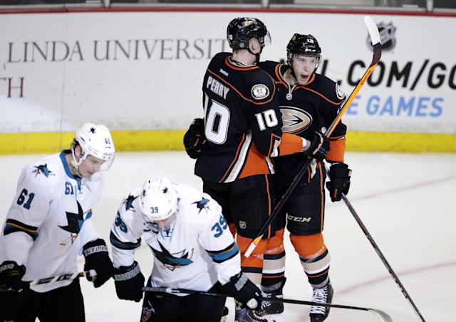 Anaheim Ducks' Corey Perry(10) and Nick Bonino(13) celebrate Bonino's goal as San Jose Sharks' Justin Braun(61) and Logan Couture(39) skate during the second period of an NHL hockey game on Tuesday, Dec. 31, 2013, in Anaheim, Calif. (AP Photo/Jae C. Hong)