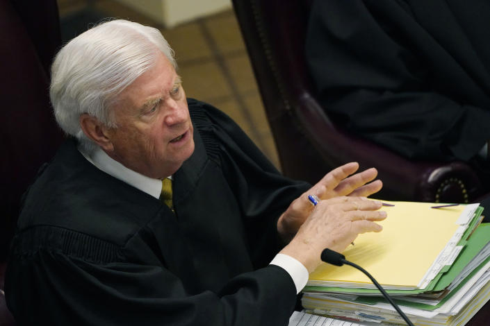 Mississippi Supreme Court Chief Justice Michael Randolph questions attorneys presenting arguments over a lawsuit that challenges the state's initiative process and seeks to overturn a medical marijuana initiative that voters approved in November 2020, Wednesday, April 14, 2021, in Jackson, Miss. (AP Photo/Rogelio V. Solis)