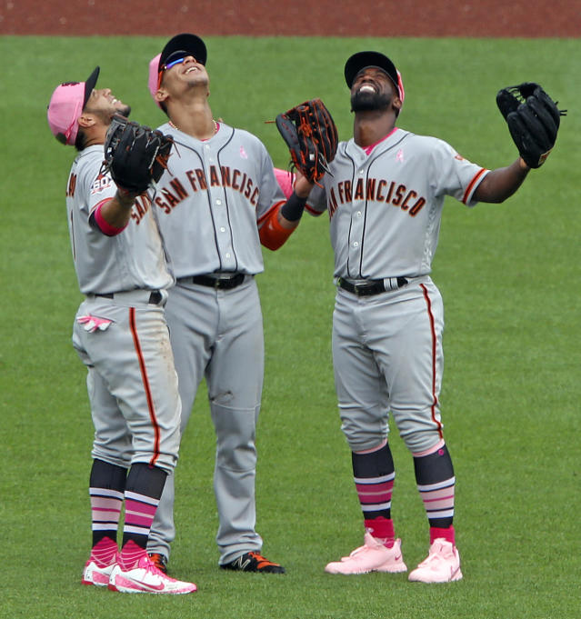San Francisco Giants outfielders Gregor Blanco, left, Gorkys Hernandez, center, and Andrew McCutchen celebrate a win over the Pittsburgh Pirates in a baseball game in Pittsburgh, Sunday, May 13, 2018. (AP Photo/Gene J. Puskar)