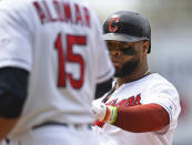 Cleveland Indians' Carlos Santana is congratulated by first base coach Sandy Alomar Jr. after an RBI single in the sixth inning of a baseball game against the New York Yankees, Sunday, June 9, 2019, in Cleveland. Oscar Mercado would score on the play. (AP Photo/David Dermer)