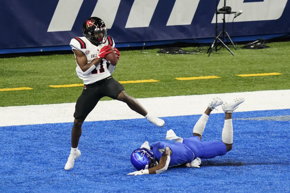 Ball State wide receiver Justin Hall (11), defended by Buffalo cornerback Isaiah King (4) catches a 9-yard pass for a touchdown during the first half of the Mid-American Conference championship NCAA college football game, Friday, Dec. 18, 2020 in Detroit. (AP Photo/Carlos Osorio)