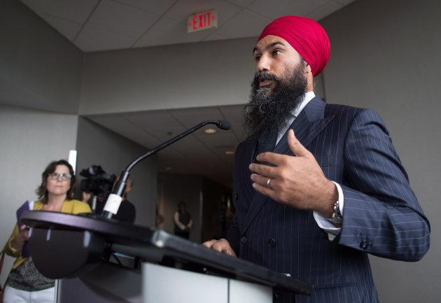 Jagmeet Singh responds to questions from reporters before the start of a three-day NDP caucus national strategy session in Surrey, B.C., on Sept. 11, 2018.