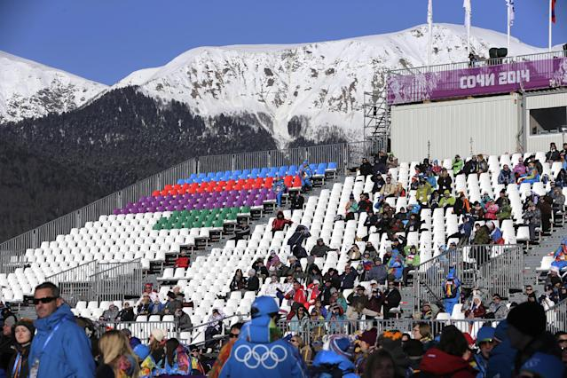 Spectators watch the women's snowboard slopestyle qualifying at the Rosa Khutor Extreme Park ahead of the 2014 Winter Olympics, Thursday, Feb. 6, 2014, in Krasnaya Polyana, Russia. (AP Photo/Andy Wong)