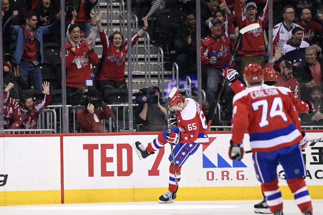 Washington Capitals left wing Andre Burakovsky (65) celebrates his goal during the first period of the team's NHL hockey game against the New Jersey Devils, Friday, March 8, 2019, in Washington. At right is Capitals defenseman John Carlson. (AP Photo/Nick Wass)