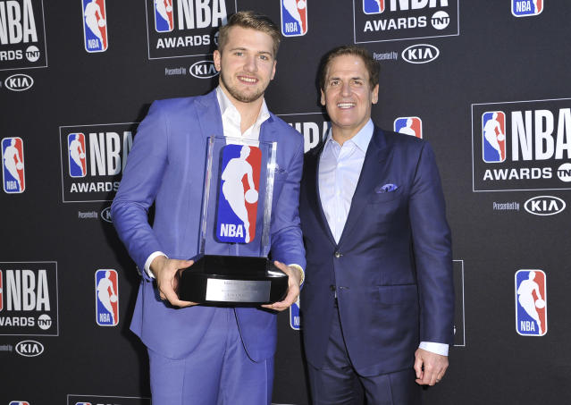 NBA player Luka Doncic, of the Dallas Mavericks, recipient of the NBA rookie of the year award, poses in the press room with Mark Cuban, governor of the Dallas Mavericks, at the NBA Awards on Monday, June 24, 2019, at the Barker Hangar in Santa Monica, Calif. (Photo by Richard Shotwell/Invision/AP)