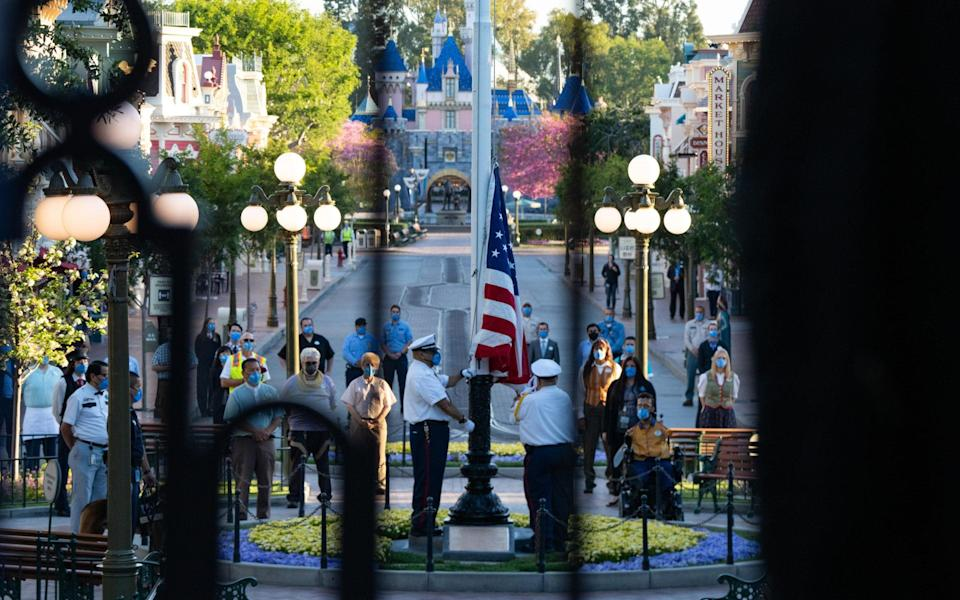 Disneyland reopened with a flag-raising ceremony - Bloomberg