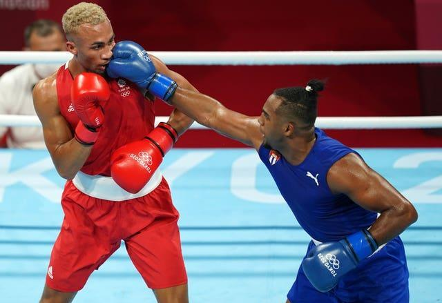 Cuba's Arlen Lopez, right, is now a two-time Olympic champion (Mike Egerton/PA)