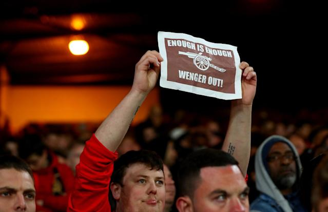 <p>An Arsenal fan protests about Arsene Wenger</p>