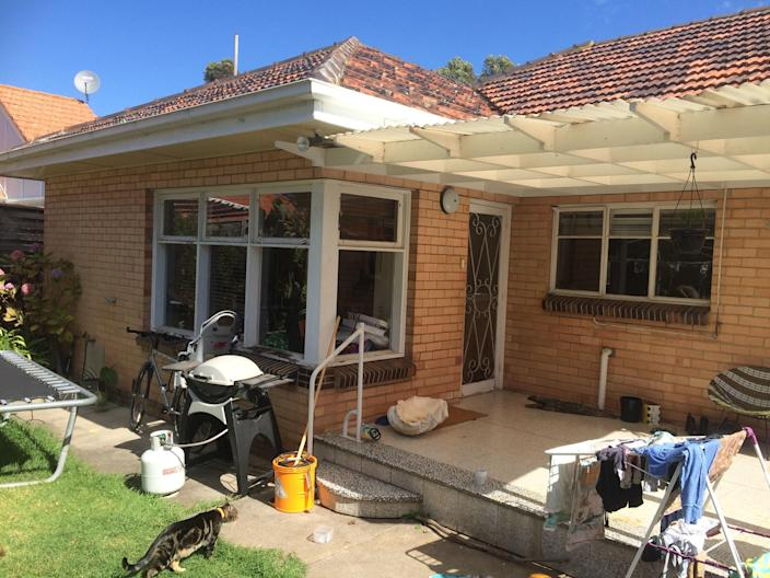 BEFORE: When the family first moved in, the outdoor area was in total disarray.