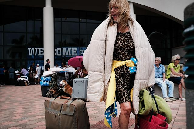 <p>A woman arrives at a shelter at Alico Arena where thousands of Floridians are hoping to ride out Hurricane Irma on Sept. 9, 2017 in Fort Myers, Fla. (Photo: Spencer Platt/Getty Images) </p>