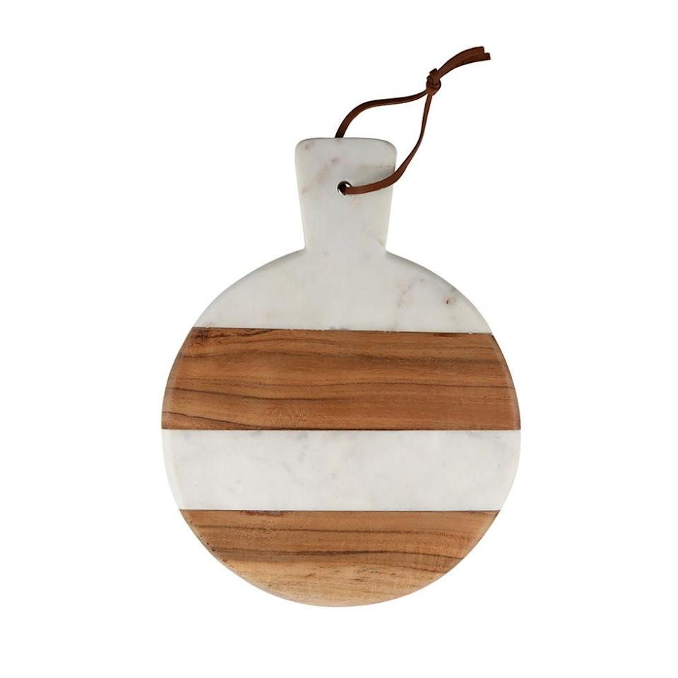 """<p>Made of real marble and wood, this platter will quickly become her favorite for serving up her famous hors d'oeuvres. ($47; <a href=""""http://www1.macys.com/shop/product/thirstystone-marble-wood-serveware-collection?ID=2325359&CategoryID=7923#fn=sp%3D1%26spc%3D21%26ruleId%3D65%26slotId%3D4%26kws%3Dthirstystone"""" rel=""""nofollow noopener"""" target=""""_blank"""" data-ylk=""""slk:macys.com"""" class=""""link rapid-noclick-resp"""">macys.com</a>)</p>"""
