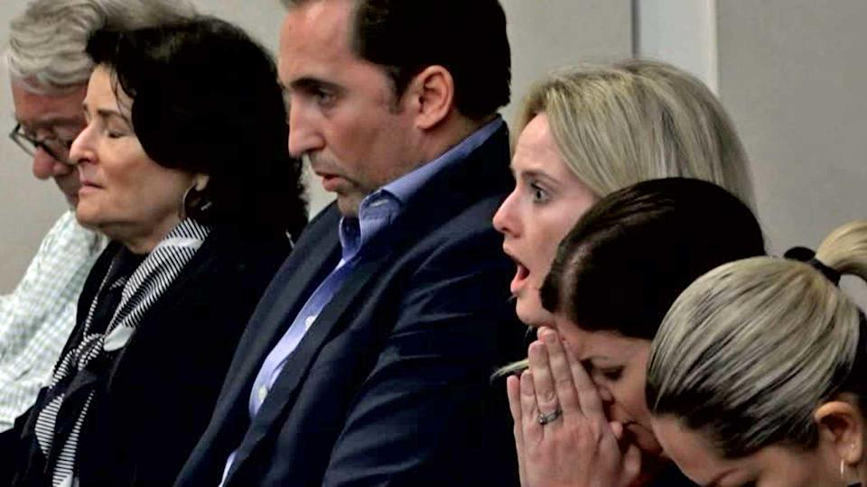 Caroline Reuschel reacts when hearing her father's guilty verdict. / Credit: CBS News