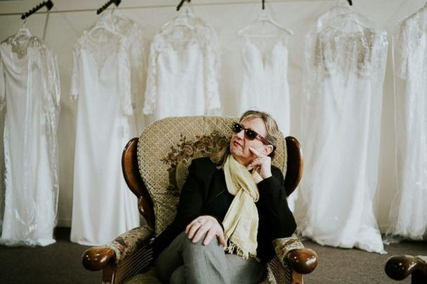 PHOTO: Blind bride Stephanie Agnew's mother, who's also blind, goes with her to try on wedding dresses in South Melbourne, Victoria, Australia. (James Day - Wedding Photographer)