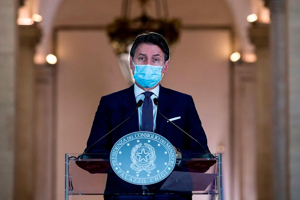 This photo taken on October 18, 2020, and provided by Italian news agency ANSA shows Italian Prime Minister Giuseppe Conte giving a press conference to present new measures to tackle the spread of the Covid-19 disease caused by the coronavirus, at Rome's Palazzo Chigi. - Conte announced on October 18, 2020, new restrictions on bars and restaurants and pushed to increase working from home. (Photo by ANGELO CARCONI / various sources / AFP) / Italy OUT (Photo by ANGELO CARCONI/POOL/AFP via Getty Images) (Photo: POOL/AFP via Getty Images)