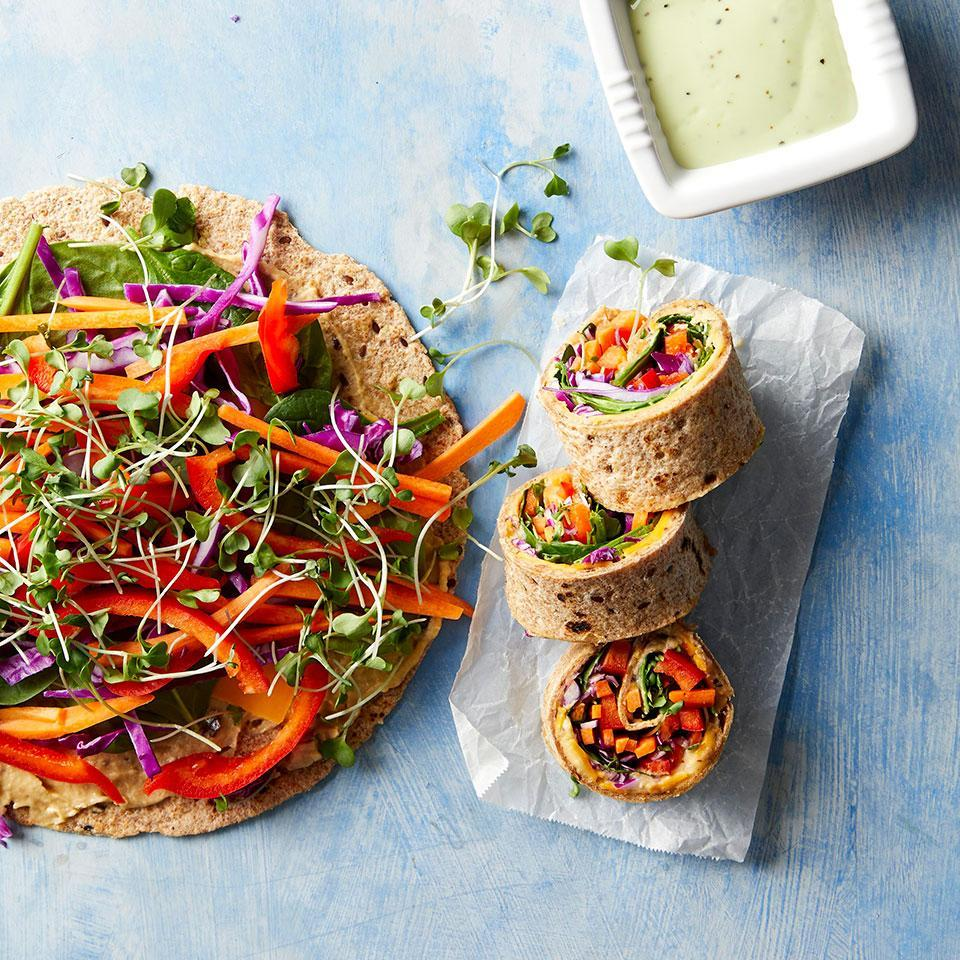 <p>There's definitely a sushi vibe to these kid-friendly wraps, which are stuffed with vegetables, cheese and hummus and then rolled and sliced. Serve them with store-bought green goddess, a creamy herb-filled dressing, to take it up a notch with ease. They look impressive but they're easy enough for kids to assemble themselves for an easy lunch or dinner.</p>