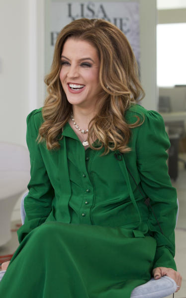"In this photo taken Thursday, May 10, 2012, singer Lisa Marie Presley poses for a photo in West Hollywood, Calif. The only child of Elvis and Priscilla Presley, Lisa Marie started writing music again after moving to Kent, southeast of London, several years ago. This led to her third album, ""Storm and Grace,"" produced by T Bone Burnett with a slow-rolling, swampy but warm Americana sound. (AP Photo/Damian Dovarganes)"