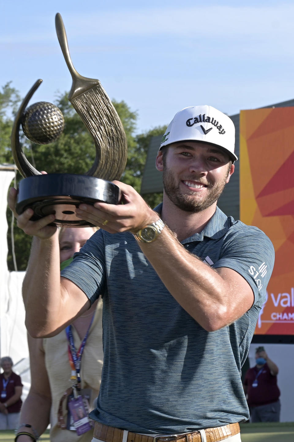 Sam Burns holds the championship trophy after winning the Valspar Championship golf tournament, Sunday, May 2, 2021, in Palm Harbor, Fla. (AP Photo/Phelan M. Ebenhack)
