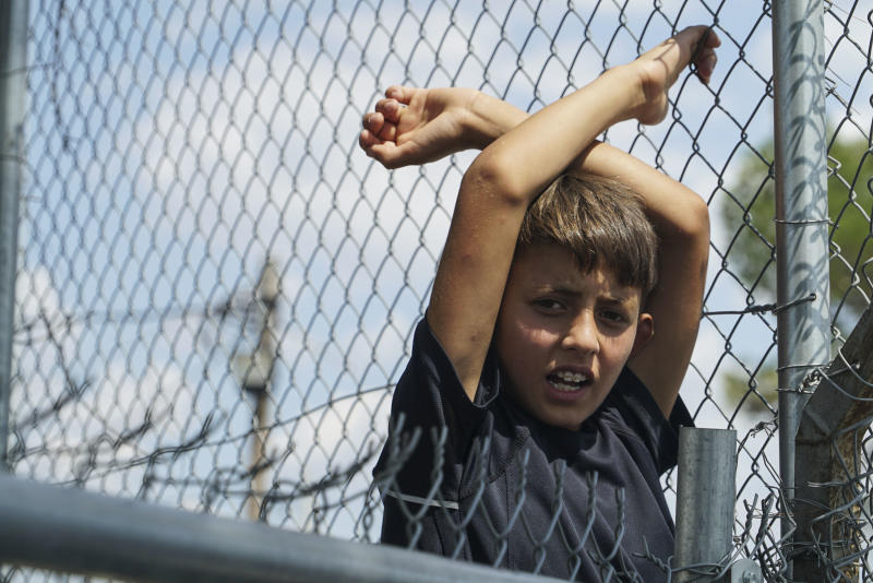 A young refugee boy languishes in the Diavata camp, located in Thessaloniki, Greece, on Aug. 17. More than 50,000 refugees are stuck in Greece, waiting either for their asylum claims to be processed or to attempt to travel elsewhere. (NurPhoto via Getty Images)
