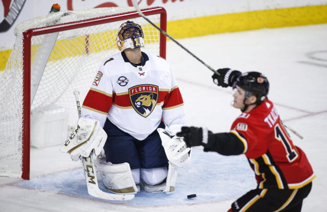 Florida Panthers goalie Roberto Luongo, left, reacts as Calgary Flames' Matthew Tkachuk celebrates his goal during third-period NHL hockey game action in Calgary, Alberta, Friday, Jan. 11, 2019. (Jeff McIntosh/The Canadian Press via AP)