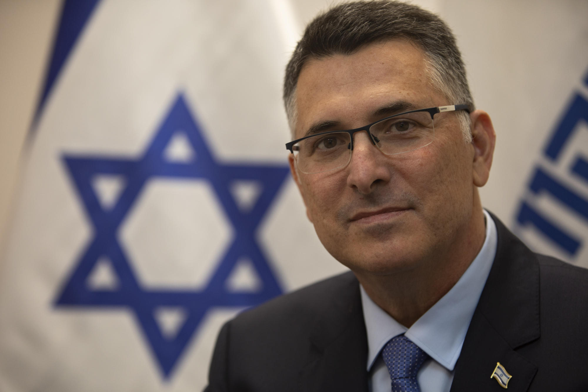 AP Interview: Netanyahu challenger pledges change with Biden
