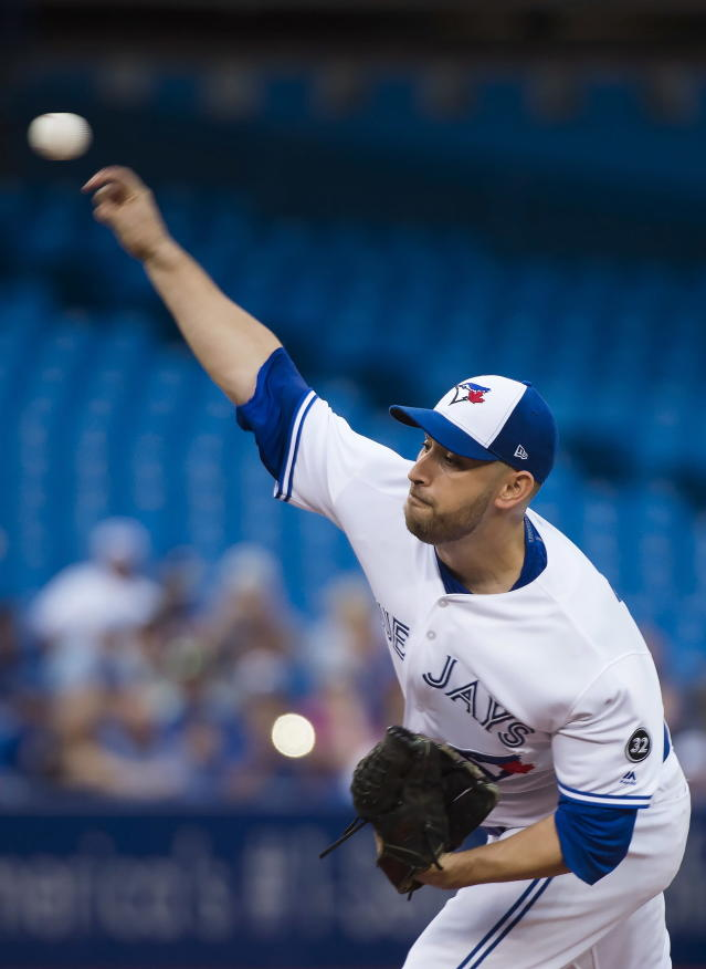 Toronto Blue Jays starting pitcher Marco Estrada (25) works against the Baltimore Orioles during first inning baseball action in Toronto on Monday, Aug. 20, 2018. (Nathan Denette/The Canadian Press via AP)