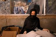 Midwife Qandi Gul registers patients at a mobile clinic for women and children near Lashkar Gah
