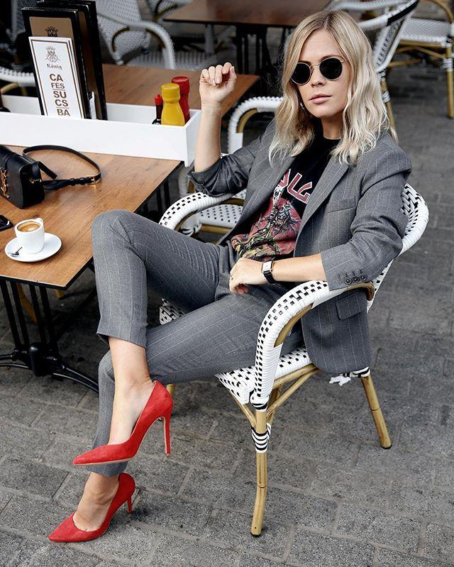 <p><strong>Styling Takeaway: </strong>Give a classic pantsuit some edge by pairing it with a band tee and red pumps. </p>