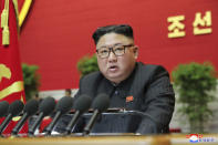 "In this photo provided by the North Korean government, North Korean leader Kim Jong Un speaks at the ruling party congress in Pyongyang, North Korean, Friday, Jan. 8, 2021. Kim threatened to expand his nuclear arsenal and develop more sophisticated weapons systems, saying the fate of relations with the United States depends on whether it abandons its hostile policy, state media reported Saturday. The congress, the Workers Party's top decision-making body, convened for the first time in five years. Independent journalists were not given access to cover the event depicted in this image distributed by the North Korean government. The content of this image is as provided and cannot be independently verified. Korean language watermark on image as provided by source reads: ""KCNA"" which is the abbreviation for Korean Central News Agency. (Korean Central News Agency/Korea News Service via AP)"