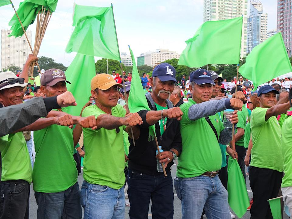 FILE PHOTO: President Duterte supporters in green shirts hold flags at the Quirino Grandstand in Manila on December 21, 2019 show their support for the president calling for both federalism and a revolutionary government. (Photo: Josefiel Rivera/SOPA Images/LightRocket via Getty Images)