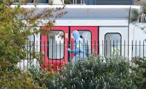 <p>A forensics officer on the platform at Parsons Green station in west London. (PA) </p>