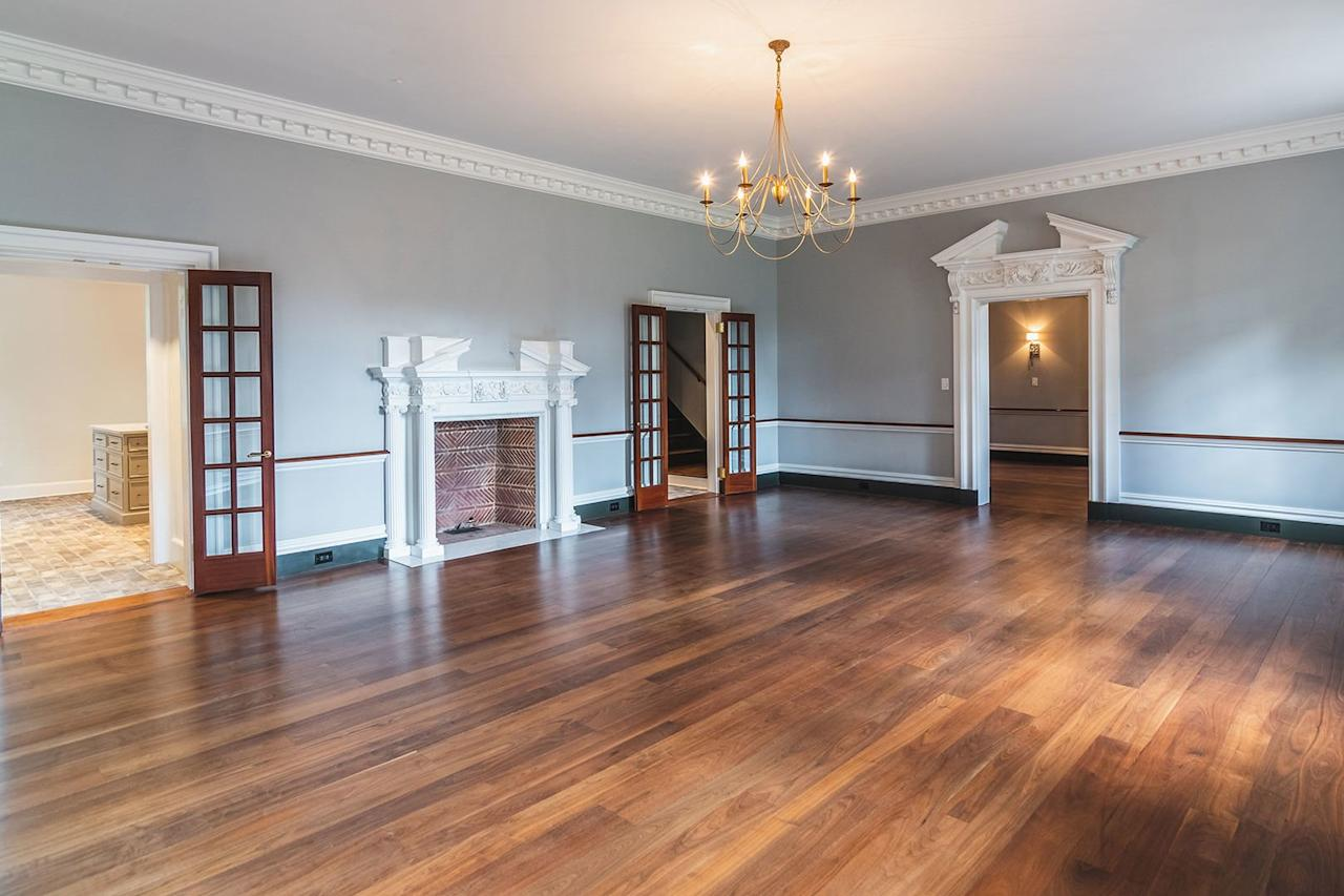 <p>The home's original three-quarter inch walnut flooring has been refinished throughout.</p>