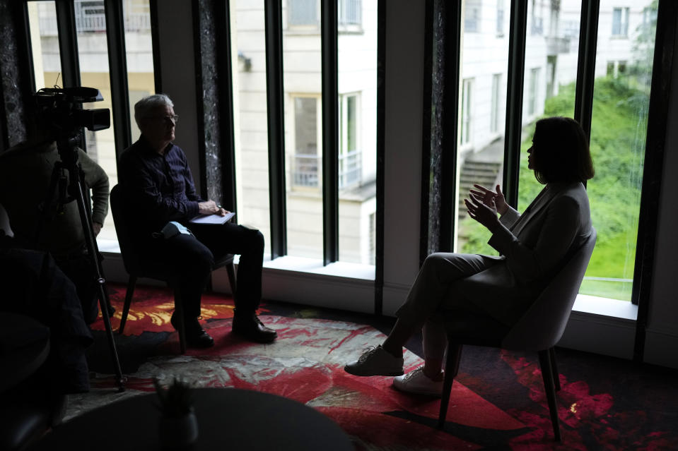 """Belarusian opposition leader Sviatlana Tsikhanouskaya, right, talks during an interview with The Associated Press in Brussels, Tuesday, June 22, 2021. Tsikhanouskaya says President Alexander Lukashenko may have miscalculated last month by diverting a Ryanair passenger jet to Minsk, where a dissident journalist aboard was arrested. The exiled novice politician says the incident has galvanized the West against Lukashenko, who had """"never crossed this red line before."""" (AP Photo/Francisco Seco)"""