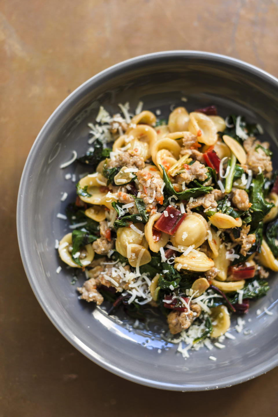 This image released by Milk Street shows a recipe for orecchiette with sausage and arugula. (Milk Street via AP)