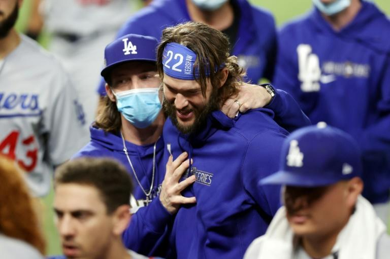 Los Angeles Dodgers pitcher Clayton Kershaw, 22, celebrates with his teammates following their 4-2 victory against the Tampa Bay Rays in game five of the 2020 World Series