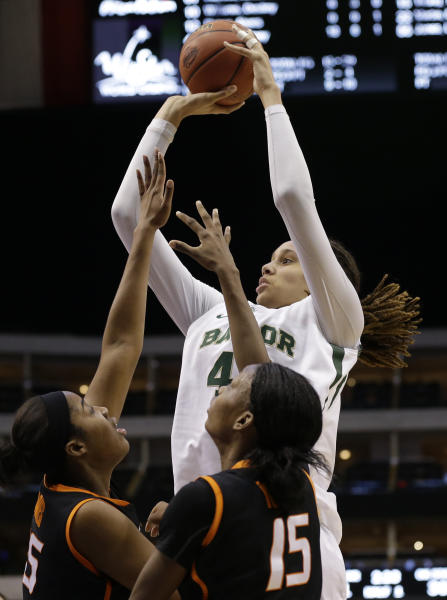 Oklahoma State' LaShawn Jones (55) and Toni Young (15) defend as Baylor's Brittney Griner (42) goes up for a score in the first half of an NCAA college basketball game in the Big 12 women's tournament on Sunday, March 10, 2013, in Dallas. (AP Photo/Tony Gutierrez)