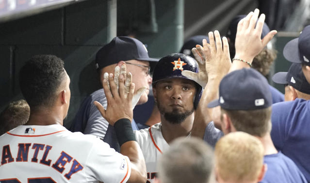 Houston Astros' Martin Maldonado, center, is congratulated in the dugout after hitting a home run against the Detroit Tigers during the fifth inning of a baseball game Tuesday, Aug. 20, 2019, in Houston. (AP Photo/David J. Phillip)