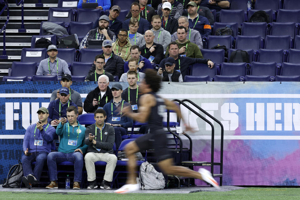 INDIANAPOLIS, IN - FEBRUARY 27: General view as team scouts time the 40-yard dash during the NFL Scouting Combine at Lucas Oil Stadium on February 27, 2020 in Indianapolis, Indiana. (Photo by Joe Robbins/Getty Images)
