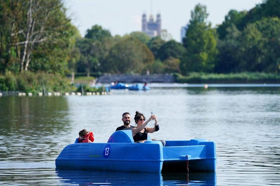 Sun-lovers on the Serpentine in Hyde Park  (PA)