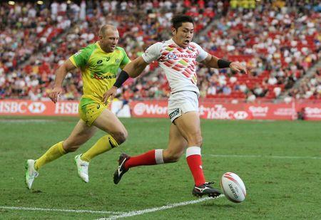 Rugby Union - HSBC Singapore Sevens - HSBC Sevens World Series - National Stadium, Singapore - 16/4/16 Japan's Teruya Goto (R) is chased by Australia's James Stannard as he runs through to score a try during the pool stage Action Images via Reuters / Jeremy Lee Livepic