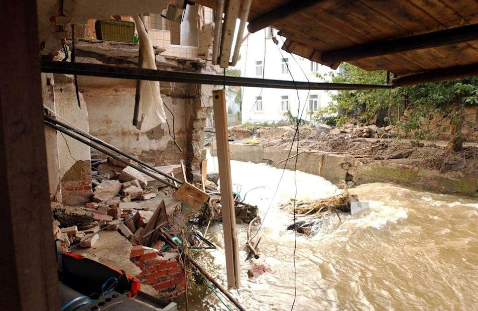 A house demolished by a massive flood in Southern Germany. Such downpours are now heavier (PA) (PA Archive)