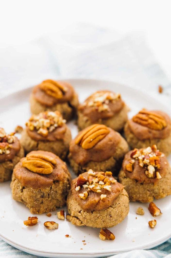 """<p>There's a whole lot of pecan flavor in these sugar cookies: It's used in the cookie dough <em>and</em> the frosting for a sweet, nutty finish.</p><p><strong>Get the recipe at <a href=""""https://jessicainthekitchen.com/maple-pecan-sugar-cookies/"""" rel=""""nofollow noopener"""" target=""""_blank"""" data-ylk=""""slk:Jessica in the Kitchen"""" class=""""link rapid-noclick-resp"""">Jessica in the Kitchen</a>.</strong><br></p><p><a class=""""link rapid-noclick-resp"""" href=""""https://go.redirectingat.com?id=74968X1596630&url=https%3A%2F%2Fwww.walmart.com%2Fsearch%3Fq%3Dcookie%2Bscoop&sref=https%3A%2F%2Fwww.thepioneerwoman.com%2Ffood-cooking%2Fmeals-menus%2Fg36875717%2Ffall-cookies%2F"""" rel=""""nofollow noopener"""" target=""""_blank"""" data-ylk=""""slk:SHOP COOKIE SCOOPS""""> SHOP COOKIE SCOOPS</a></p>"""