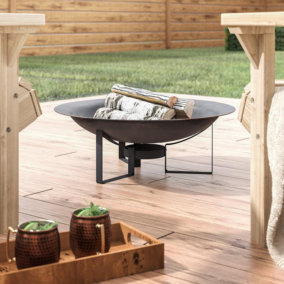 <p>Winter gatherings go hand-in-hand with this <span>Buendia Rustic Bowl Cast Iron Wood Burning Fire Pit</span> ($70, originally $94).</p>