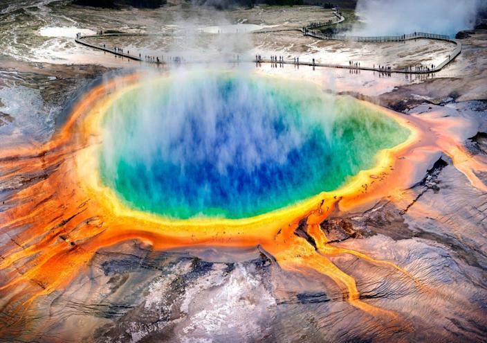 "<p>It's hard to believe that photos of the <a href=""https://www.yellowstonepark.com/things-to-do/grand-prismatic-midway-geyser-basin"" rel=""nofollow noopener"" target=""_blank"" data-ylk=""slk:Grand Prismatic Spring"" class=""link rapid-noclick-resp"">Grand Prismatic Spring</a> aren't photoshopped. This natural pool with rainbow colors is the biggest hot spring in the U.S., and the third largest in the world. It's located in Yellowstone National Park, which will make for a great weeklong (or longer!) escape from reality. </p>"