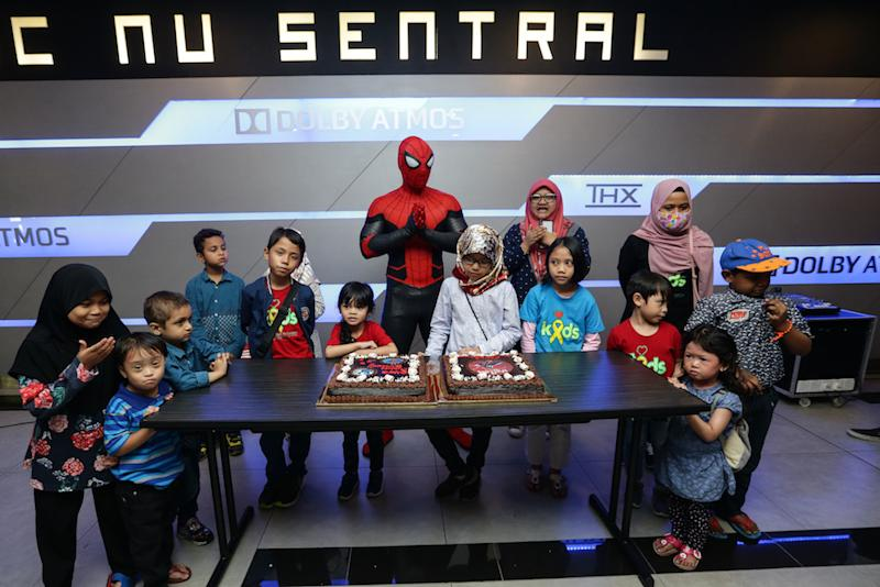 Children who were born in July celebrate their birthday with Spider-Man mascot after the movie screening. — Picture by Ahmad Zamzahuri
