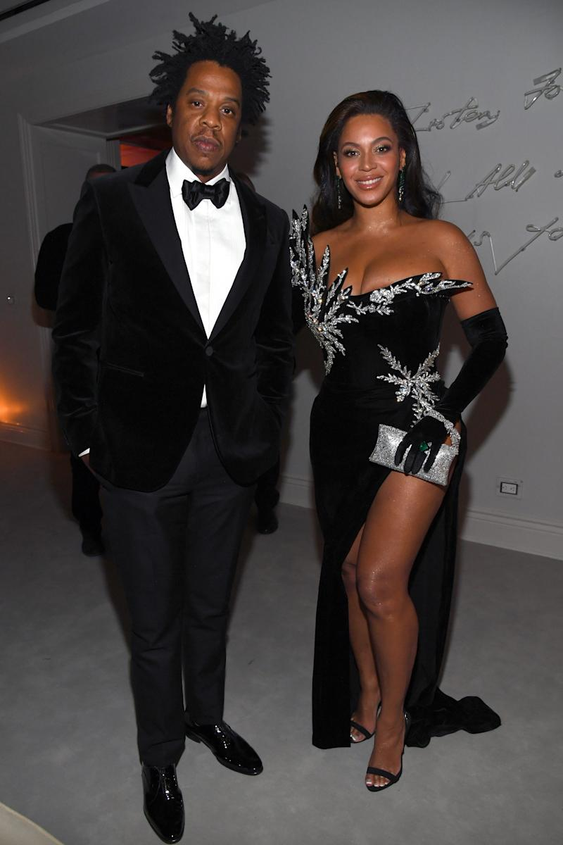 Jay-Z and Beyonce attend Diddy's 50th birthday party.