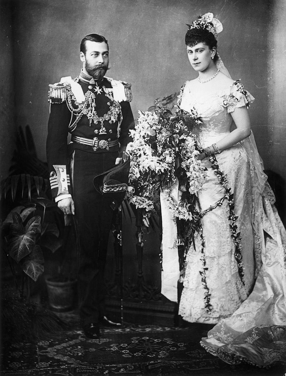 """<p>King George V proposed to Mary of Teck in May 1893 under unusual circumstances. Mary was <a href=""""https://www.thehistorypress.co.uk/articles/royal-engagement-rings-through-the-centuries/"""" rel=""""nofollow noopener"""" target=""""_blank"""" data-ylk=""""slk:previously engaged to his older brother"""" class=""""link rapid-noclick-resp"""">previously engaged to his older brother</a>, Prince Albert Victor, who died of pneumonia during their engagement in 1892. The couple was pressured into marriage and wed on July 6, 1893. </p>"""