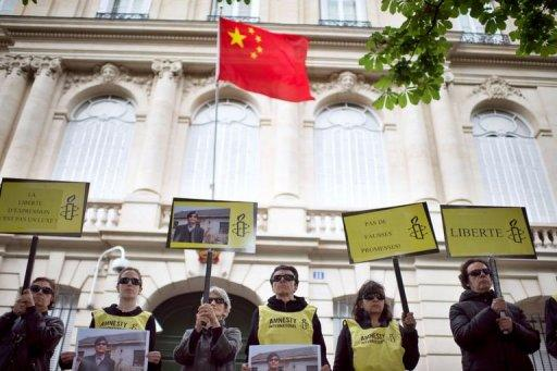 Amnesty International activists take part in a protest in support of blind Chinese activist Chen Guangcheng in Paris