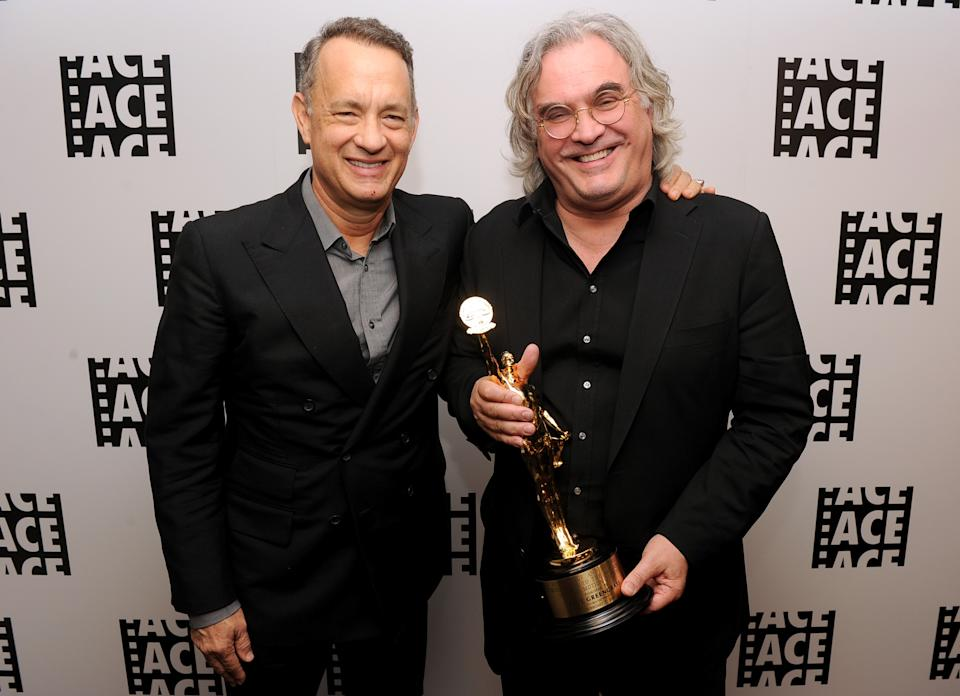 BEVERLY HILLS, CA - FEBRUARY 07:  Actor Tom Hanks (L) and director Paul Greengrass pose in the green room at the 64th Annual ACE Eddie Awards at the Beverly Hilton Hotel on February 7, 2014 in Beverly Hills, California. (Photo by Kevin Winter/Getty Images)