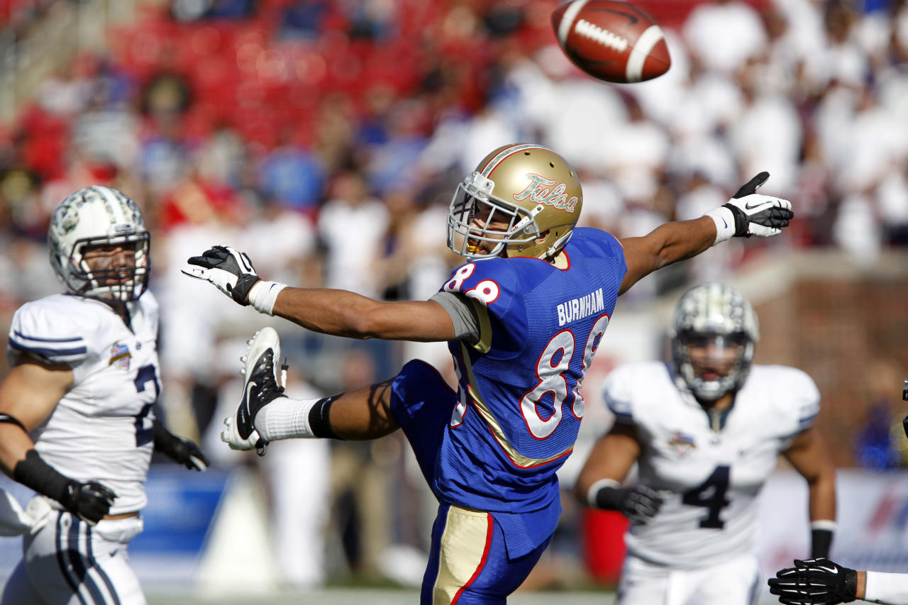 Tulsa wide receiver Bryan Burnham (88) can't hold onto a pass as BYU linebacker Spencer Hadley (2) and linebacker Uona Kaveinga (4) watch the play during the fourth quarter of the Armed Forces Bowl NCAA college football game on Friday, Dec. 30, 2011, in Dallas. BYU won 24-21. (AP Photo/John F. Rhodes)
